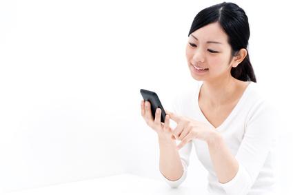 beautiful asian woman using cellphoe